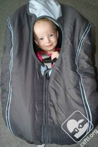 Shower cap style car seat covers don't interfere with the harness and are generally a safe alternative