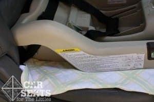 Thin receiving blanket underneath a car seat base