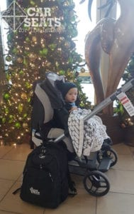 Attach a car seat to the stroller, then have your kiddo ride through the airport