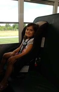 Forward facing car seat installed on a school bus. Image courtesy of NHTSA Image Library.