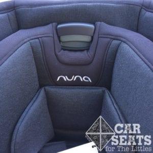 Nuna RAVA harness adjustment button