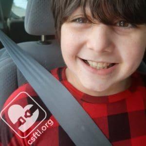 9 year old - with booster seat - shoulder belt centered on the shoulder